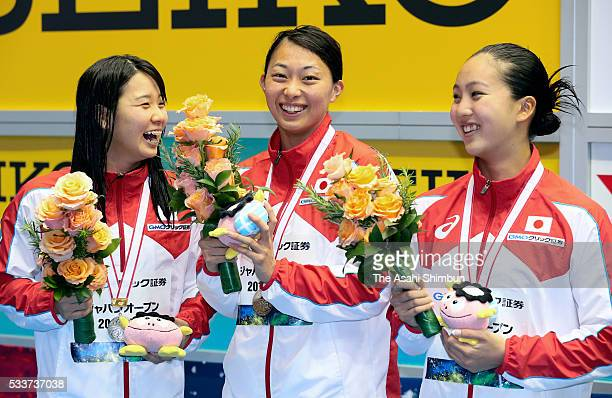 Second place Miho Teramura first place Satomi Suzuki and third place Kanako Watanabe celebrate on the podium at the medal ceremony for the Womens'...
