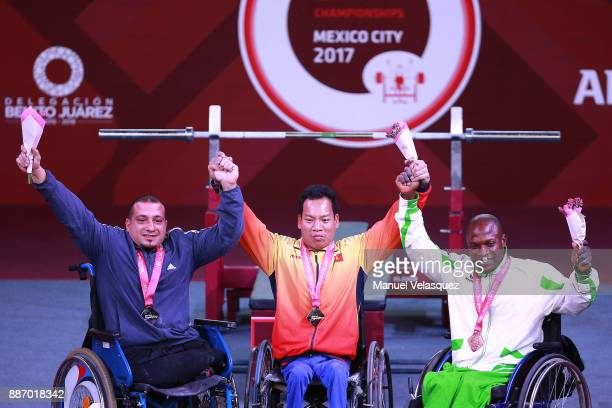 Second Place Omar Qarada of Jordan First place Van Cong Le of Vietnam and Third Place Yakubu Adesokan of Nigeria celebrate with their medals after...