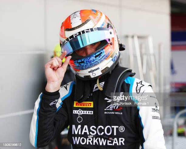 Second place qualifier Christian Lundgaard of Denmark and ART Grand Prix gestures in parc ferme during qualifying ahead of Round 1:Sakhir of the...