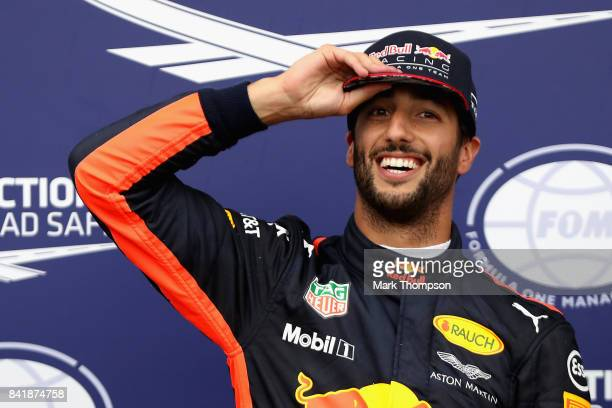 Second place qualifier Daniel Ricciardo of Australia and Red Bull Racing celebrates in parc ferme during qualifying for the Formula One Grand Prix of...