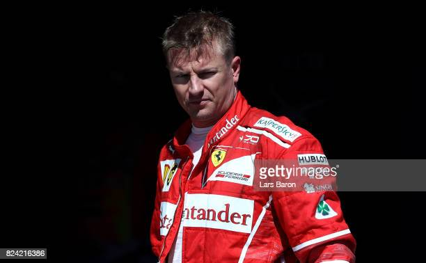 Second place qualifier Kimi Raikkonen of Finland and Ferrari in parc ferme during qualifying for the Formula One Grand Prix of Hungary at Hungaroring...