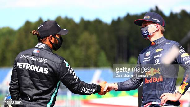 Second place qualifier Lewis Hamilton of Great Britain and Mercedes GP and third place qualifier Max Verstappen of Netherlands and Red Bull Racing...
