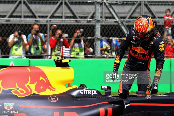 Second place qualifier Max Verstappen of Netherlands and Red Bull Racing climbs out of his car in parc ferme during qualifying for the Formula One...