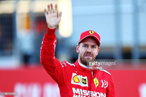 Second place qualifier Sebastian Vettel of Germany and Ferrari celebrates in parc ferme during qualifying for the F1 Grand Prix of USA at Circuit of...