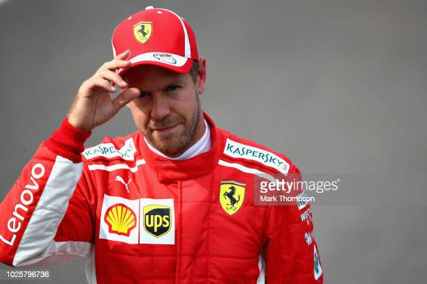 Second place qualifier Sebastian Vettel of Germany and Ferrari looks on from parc ferme during qualifying for the Formula One Grand Prix of Italy at...