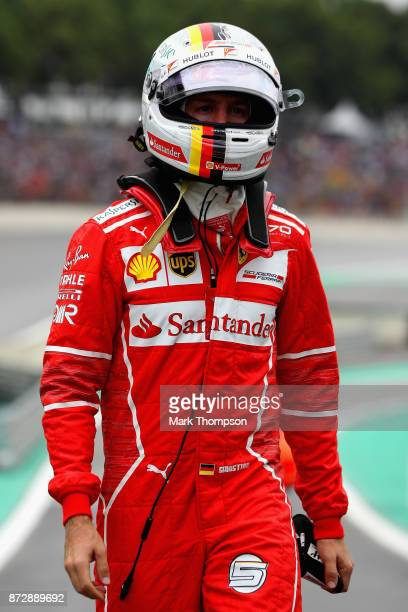 Second place qualifier Sebastian Vettel of Germany and Ferrari walks to parc ferme during qualifying for the Formula One Grand Prix of Brazil at...