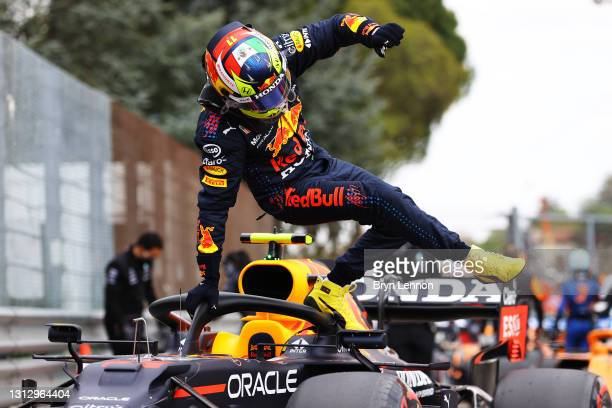 Second place qualifier Sergio Perez of Mexico and Red Bull Racing climbs from his car in parc ferme during qualifying ahead of the F1 Grand Prix of...