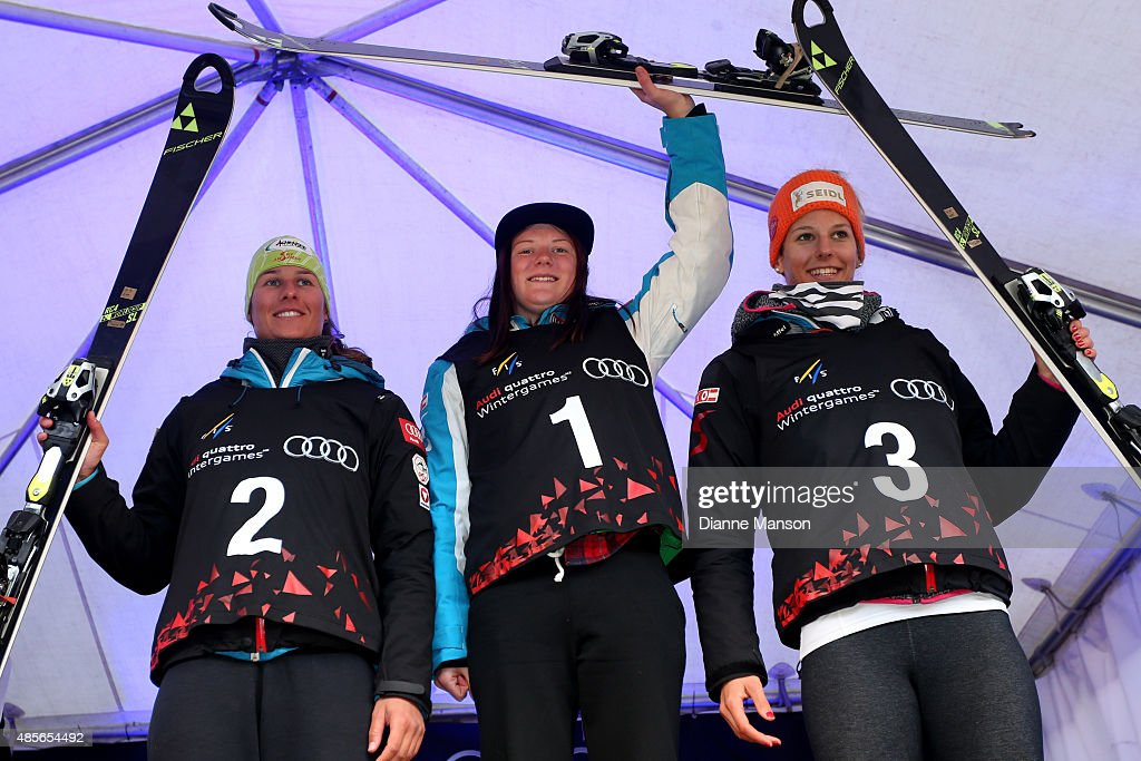 Second place Ricarda Hasser, first place Katherine Truppe and third place Elisabeth Kappaurer of Austria pose during the medal ceremony for the Alpine Slalom - FIS Australia New Zealand Cup during the Winter Games NZ on August 29, 2015 in Queenstown, New Zealand.