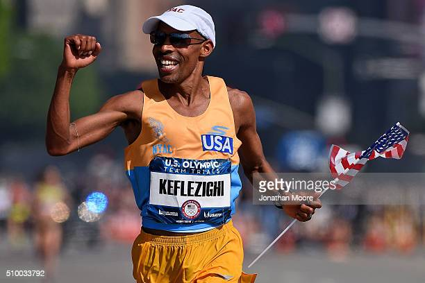 Second place runner Meb Keflezighi celebrates as he approaches the finish line during the US Olympic Marathon Team Trials on February 13 2016 in Los...