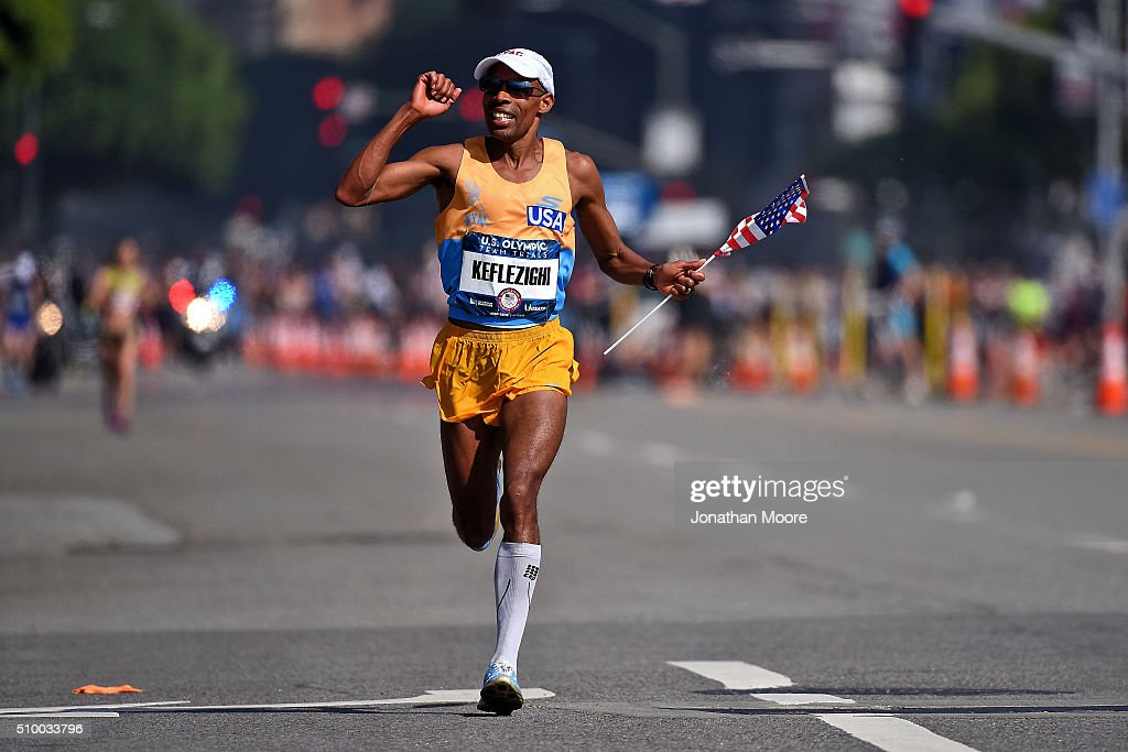 Second place runner Meb Keflezighi celebrates as he approaches the finish line during the U.S Olympic Marathon Team Trials on February 13, 2016 in Los Angeles, California.
