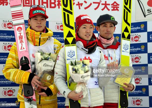Second place Ryoyu Kobayashi winner Junshiro Kobayashi and third place Daiki Ito stand on the podium at the medal ceremony during the Ski Jumpin UHB...
