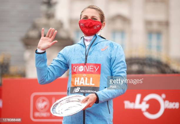 Second place Sara Hall of The United States of America celebrates following competing in the Elite Women's Field during the 2020 Virgin Money London...