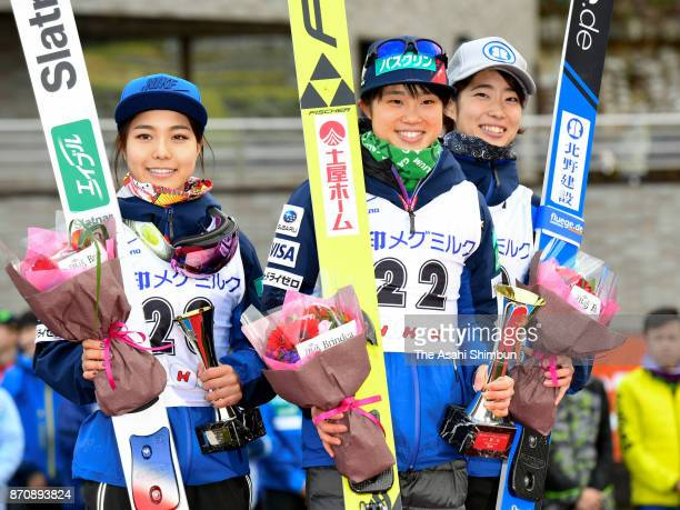 Second place Sara Takanashi, winner Yuki Ito and third place Kaori Iwabuchi pose on the podium at the medal ceremony for the Women's event during the...