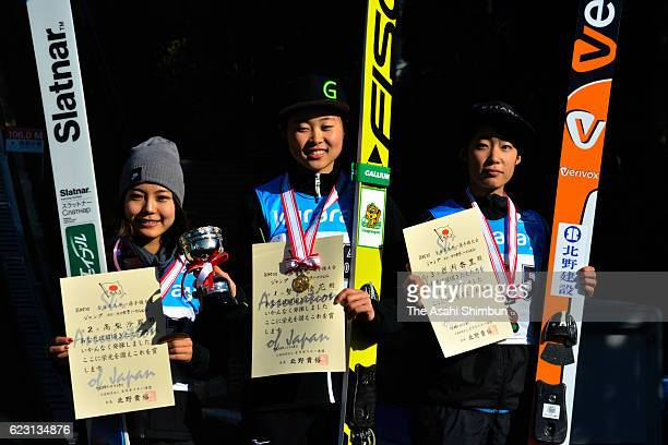 Second place Sara Tanakashi, first place Yuka Seto and third place Kaori Iwabuchi pose on the podium at the medal ceremony for the women's...