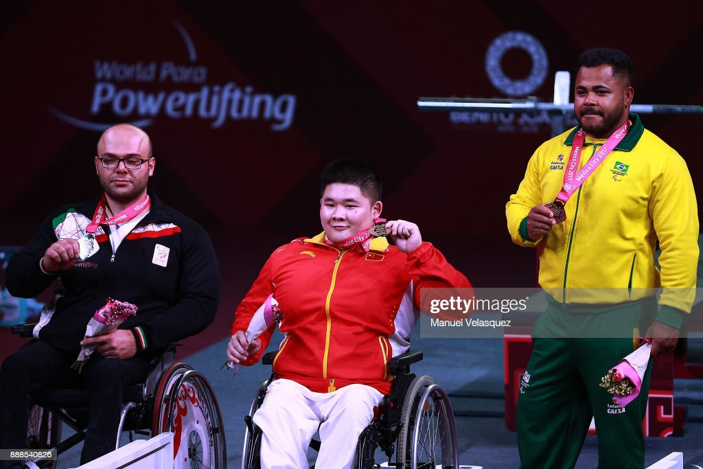 Second Place, Seyedhamed Solhipouravanji (L) of Iran, First Place, Jixiong Ye (C) of China, Third Place, Evanio Da Silva (R) of Brazil celebrates with their medals during the Men's Upt to 88Kg Group B Category as part of the World Para Powerlifting Championship Mexico 2017 at Juan de la Barrera Olympic Gymnasium on December 6, 2017 in Mexico City, Mexico.