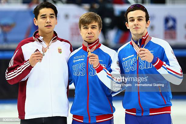 Second place Shaolin Sandor Liu of Hungary winner Semen Elistratov of Russia and third place Dmitry Migunov of Russia pose with their medals...