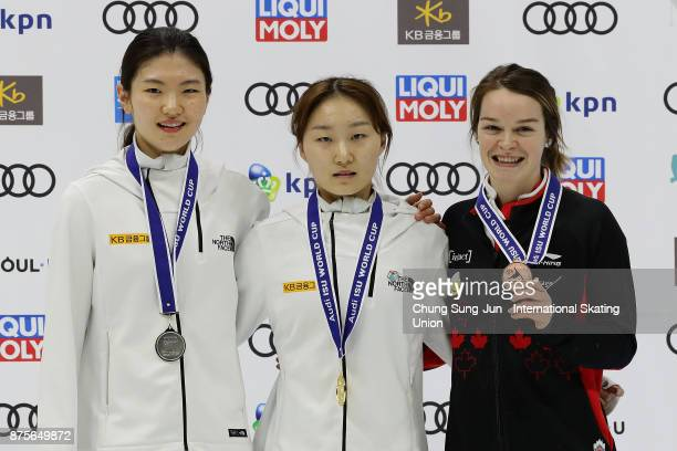 Second place Shim SukHee of South Korea first place Choi MinJeong of South Korea and Kim Boutin of Canada celebrate during the victory ceremony for...