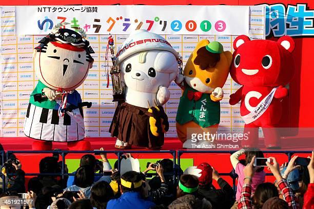 Second place 'ShusseDaimyo Ieyasukun' winner 'Sanomaru' and third place 'Gunma chan' are seen at the YuruKyara Garnd Prix 2013 during the YuruKyara...