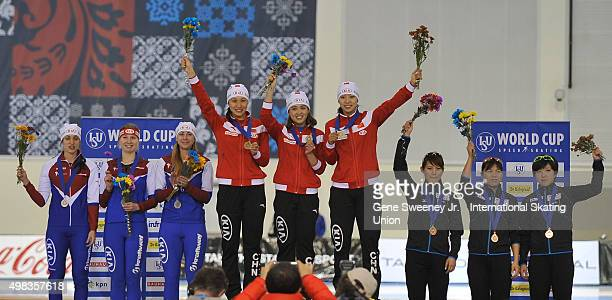 Second place team Russia first place team China and third place team Japan on the podium after the Ladies Team Sprint event on day three of the ISU...