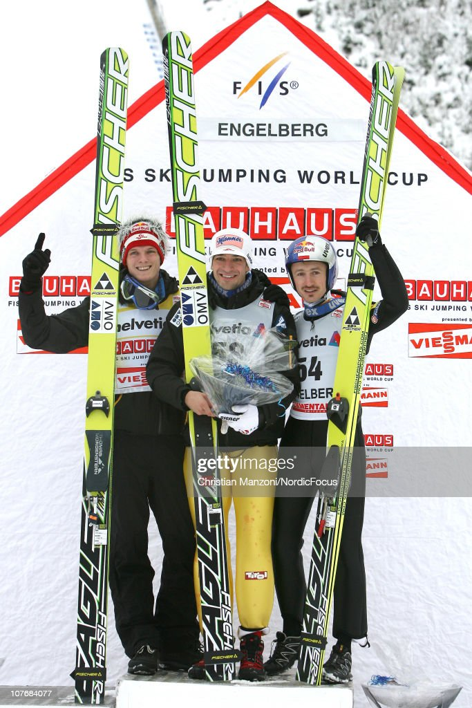 Second place Thomas Morgenstern of Austria celebrates with first place winner Andreas Kofler of Austria and third place Adam Malysz of Poland after the individual HS 137 during the FIS Ski Jumping World Cup on December 19, 2010 in Engelberg, Switzerland.