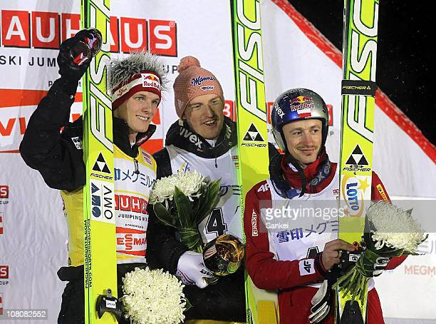 second place Thomas Morgenstern of Austria winner Severin Freund of Germany and third place Adam Malysz of Poland competes in the day one of the FIS...