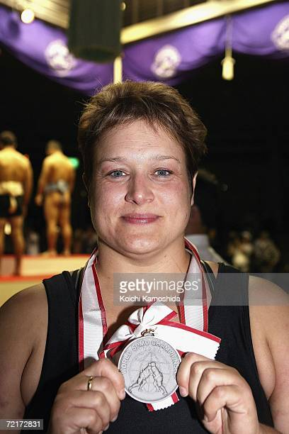 Second place winner Adele Jones of England poses with her silvermedal after competing in the women's Open Division during the 5th Shinsumo World...
