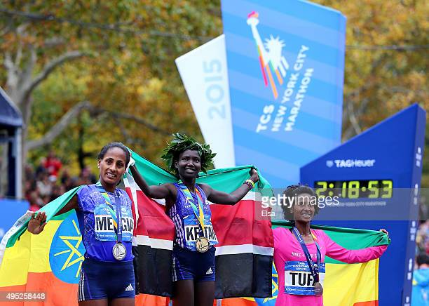 Second place winner Aselefech Mergia of Ethiopia, first place winner Mary Keitany of Kenya and third place winner Tigist Tufa of Ethiopia pose with...