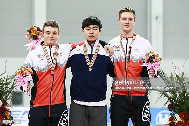 Second place winner Christopher Fiola of Canada first place winner Min Seok Kim of Korea and third place winner Benjamin Donnelly of Canada pose for...