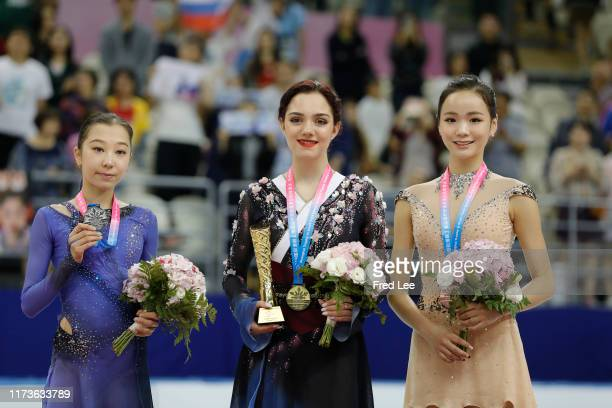 Second place winner Elizabet Tursynbaeva of Kazakhstan, First place winner Evgenia Medvedeva of Russia and Third place winner Eunsoo Lim of Korea...