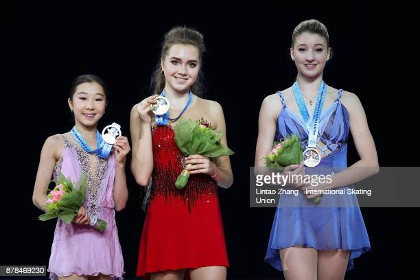 Second place winner Elizabet Tursynbaeva of Kazakhstan First place winner Elena Radionova of Russia and Third place winner Maria Sotskova of Russia...