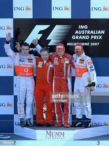 Second place winner Fernando Alonso of Spain and McLaren Mercedes Ferrari Team Principal Jean Todt winner Kimi Raikkonen of Finland and Ferrari and...