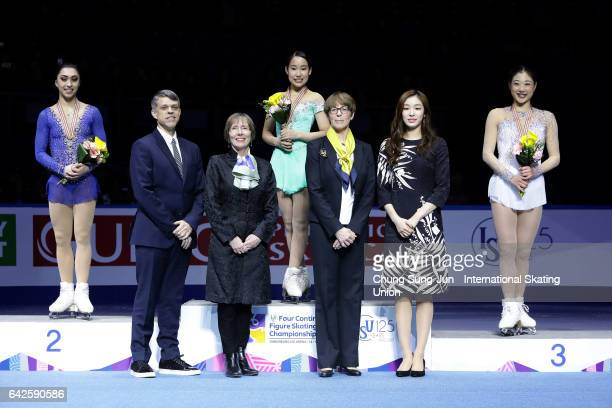 Second place winner Gabrielle Daleman of Canada first place winner Mai Mihara of Japan and third place winner Mirai Nagasu of United States pose with...