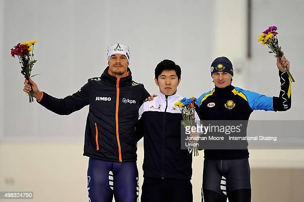 Second place winner Hein Otterspeer of The Netherlands first place winner TaeYun Kim of South Korea and third place winner Roman Krech of Kazakhstan...