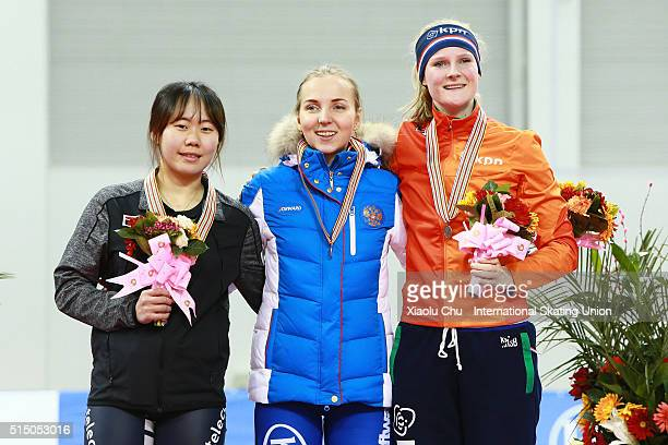 Second place winner Ji Woo Park first place winner Elizaveta Kazelina of Russia and third place winner Esther Kiel of Netherlands pose for photo on...