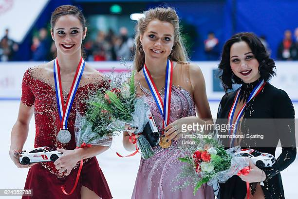 Second place winner Kaetlyn Osmond of Canada First place winner Elena Radionova of Russia Third place winner Elizaveta Tuktamysheva of Russia pose on...