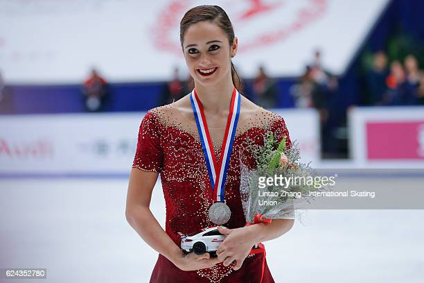 Second place winner Kaetlyn Osmond of Canada pose on the podium during the medals ceremony of the Ladies Free Skating on day two of Audi Cup of China...