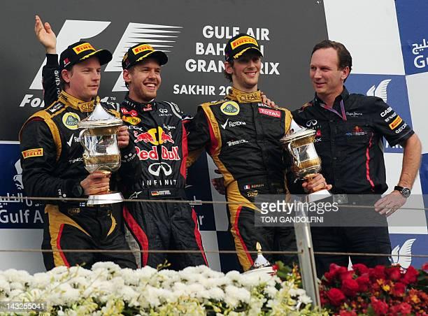 Second place winner Lotus F1 Team's Finnish driver Kimi Raikkonen, first place winner Red Bull Racing's German driver Sebastian Vettel, third place...