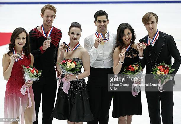 Second place winner Madison Chock and Evan Bates of United States, First place winner Anna Cappellini and Luca Lanotte of Italia and Third place...