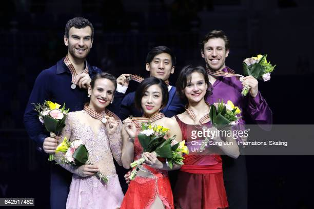 Second place winner Meagan Duhamel and Eric Radford of Canada first place winner Wenjing Sui and Cong Han of China and third place winner Liubov...