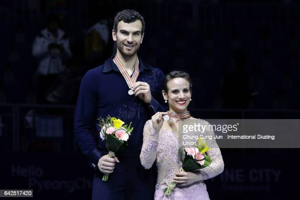 Second place winner Meagan Duhamel and Eric Radford of Canada pose on the podium after the medals ceremony of the Pairs during ISU Four Continents...