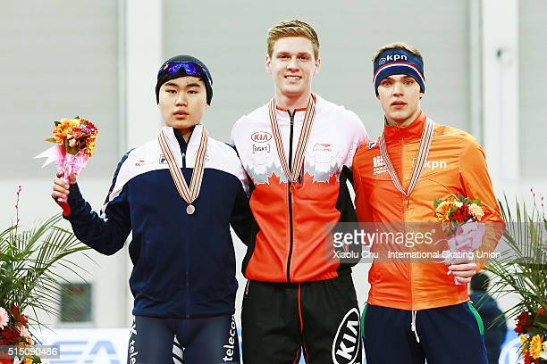 Second place winner Min Seok Kim of Korea first place winner Benjamin Donnelly of Canada and third place winner Chris Huizinga of Netherlands pose...