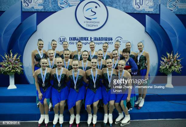 Second place winner Team Marigold Iceunity of Finland pose on the podium after the Synchronized Skating free skate duirng the 2017 Shanghai Trophy at...