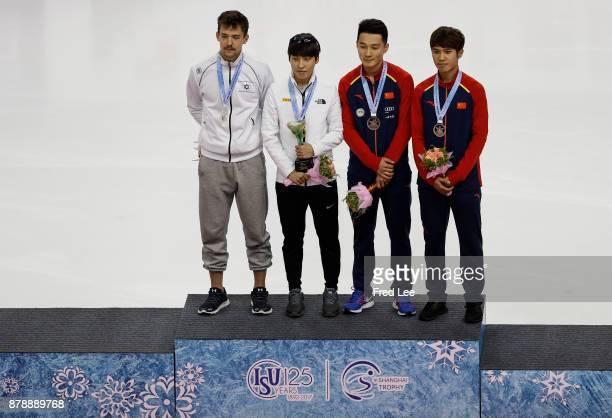 Second place winner Vladislav Bykanov of Israel First place winner Jiwon Park of Korea and Third place winner Ren Zhiwei and Chen Dequan of China...