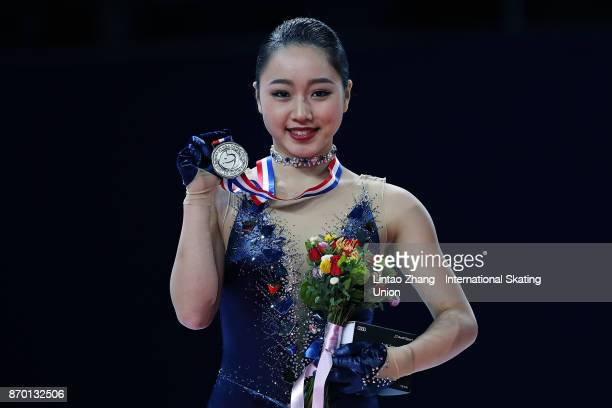 Second place winner Wakaba Higuchi of Japan poses on the podium during the medals ceremony on day two of Audi Cup of China ISU Grand Prix of Figure...