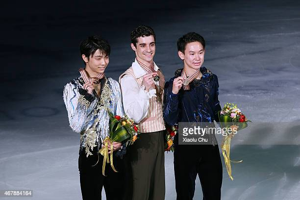Second place winner Yuzuru Hanyu of Japan first place winner Javier Fernandez of Spain third place winner Denis Ten of Kazakhstan pose for photo...