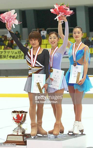 Second place Yoshie Onda first place Fumie Suguri and third place Shizuka Arakawa pose on the podium at the medal ceremony for the Women's Singles...