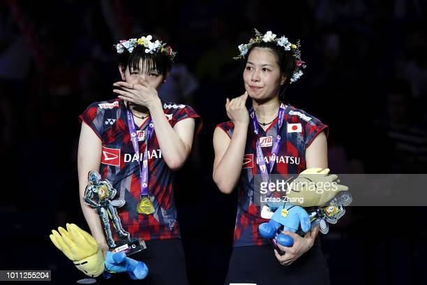 Second place Yuki Fukushima and Sayaka Hirota of Japan pose with their medals during the Women's Doubles awarding ceremony after compete against Mayu...