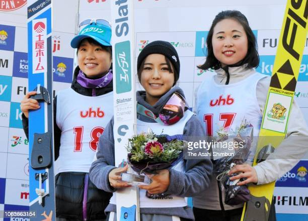 Second place Yuki Ito Winner Sara Takanashi and third place Yuka Seto celebrate on the podium at the medal ceremony after the Ski Jumping UHB Cup at...