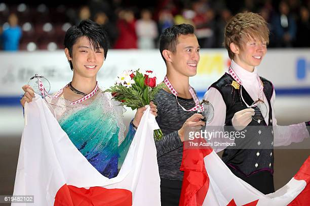 Second place Yuzuru Hanyu of Japan first place Patrick Chan of Canada and third place Kevin Reynolds of Canada pose on the podium at the medal...