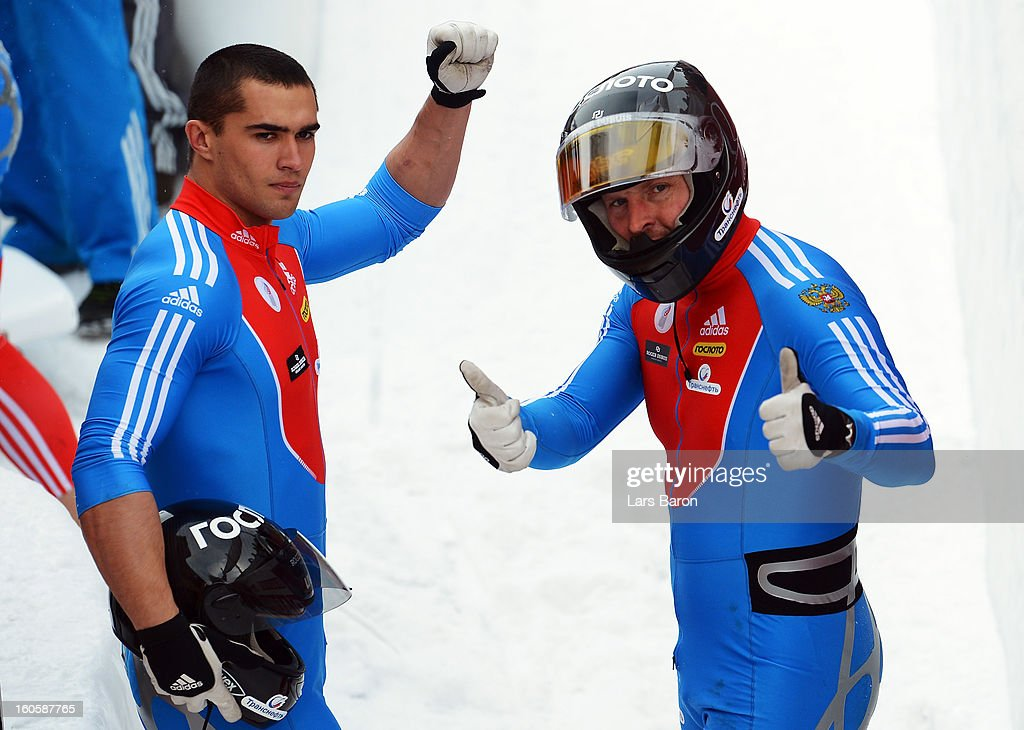Second placed Alexander Zubkov celebrates with Alexey Negodaylo after the Four Men Bobsleigh final heat of the IBSF Bob & Skeleton World Championship at Olympia Bob Run on February 3, 2013 in St Moritz, Switzerland.